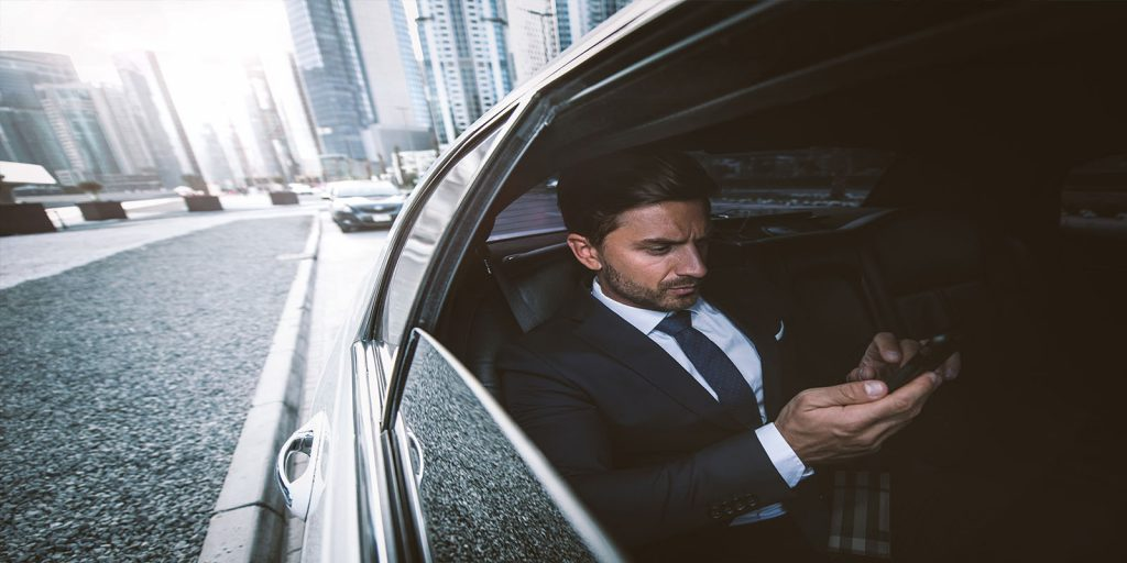 Business man in car on the phone