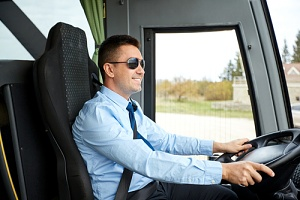 a man who drives luxury motor coaches