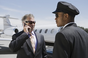executive looking for his airport chauffeur services