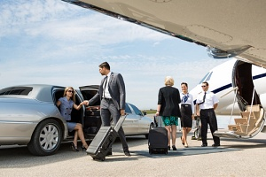 group of people using luxury limousines to get around