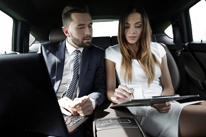 man and woman using corporate chauffeur services