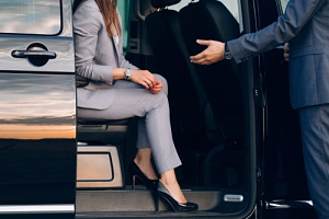 woman getting out of an executive van service