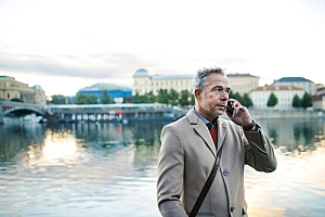 Businessman on phone while traveling in Prague