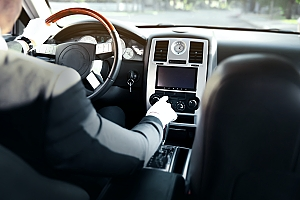 Interior of luxury car with chauffeur
