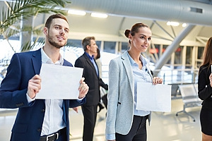 Professional drivers waiting with name cards at airport