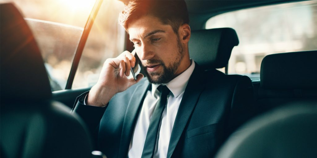 Businessman traveling and talking on phone